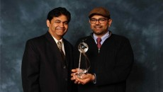 Left to right: Chuck and Jai Patel receive the IDA Humanitarian Award of the Year. Photo courtesy Overhead Door Company.