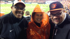Jean Fugett, JD '79, Audie (Fugett) Jones, BA '08, and Russell Fugett, MS '07, at a Baltimore Orioles game in 2014. Jean and Russell are