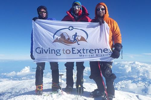 Rapp, center, at the summit.
