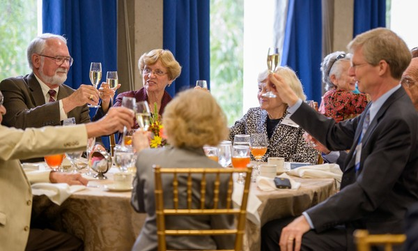 Attendees toast during Friday's Class of 1963 50-Year Reunion & Alumni Emeriti Induction Ceremony