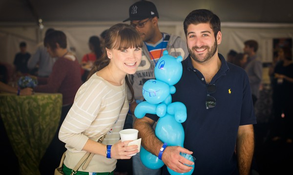 Alumni partake in balloon animal fun during Taste of GW