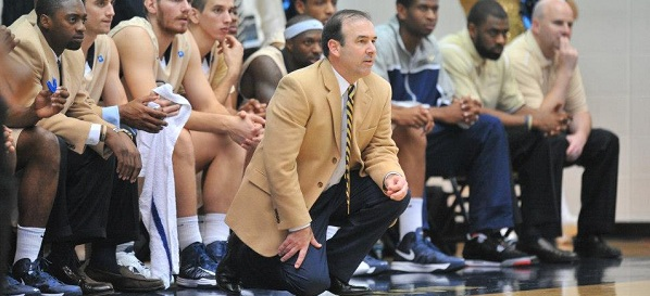 GW Men's Basketball Coach Mike Lonergan in action at a 2012 game.