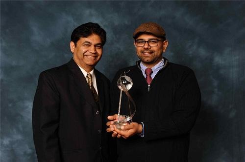 Left to right: Chuck and Jai Patel receive the IDA Humanitarian Award of the Year. Photo courtesy Overhead Door Company.