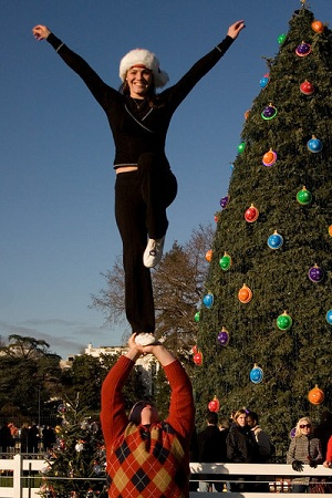 Alyscia and Paul show off a cheer stunt in front of the National Christmas Tree.