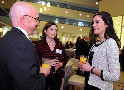 Left to right: GW Senior Associate VP of Development B.J. Davisson chats with alumnae Erin Collins and Adriana de Riva.  (Photo: Ben Soloman)