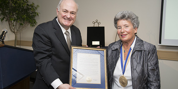 Agnes Hirschi, right, the daughter of the late Carl Lutz, accepts the GW President's Medal from University President Steven Knapp.