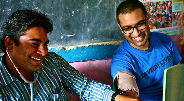 Ketan Patel, founder and director of Dr. Interns, (right) with Dr. Hitesh, a physician at Shree Prannath Hospital (left) in a clinic. (Photo: Joanne Yi)