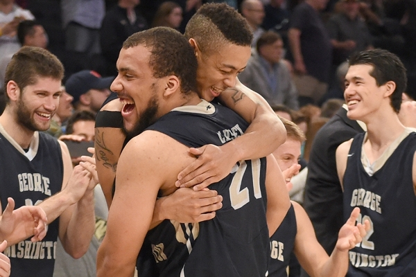 Seniors Joe McDonald and Kevin Larsen embrace as the Colonials close out a 76-60 win over Valparaiso to win the NIT championship. (GW Athletics Communications)