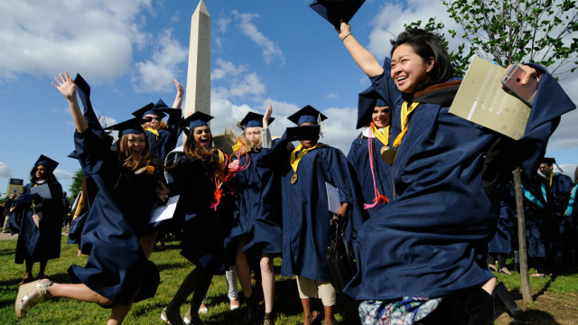 The newest members of the GW alumni family jump for joy at this year's Commencement on the National Mall. (photo: Rob Stewart)