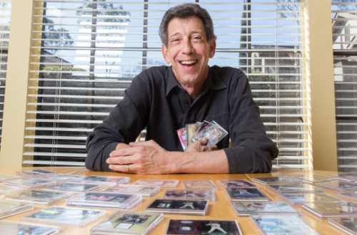 Jerry Dworkin, BBA '75, with a sampling of his unique baseball card collection, 24 of which are headed to the Baseball Hall of Fame.
