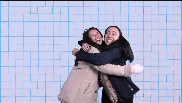 GW students embrace in holiday video