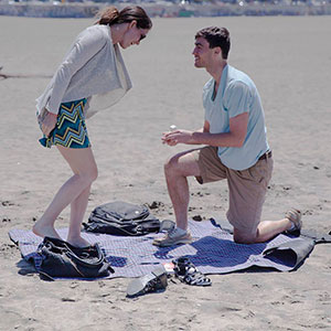 Ben proposes to Stephanie on the beach