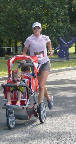 Jennifer Maher running with her two children